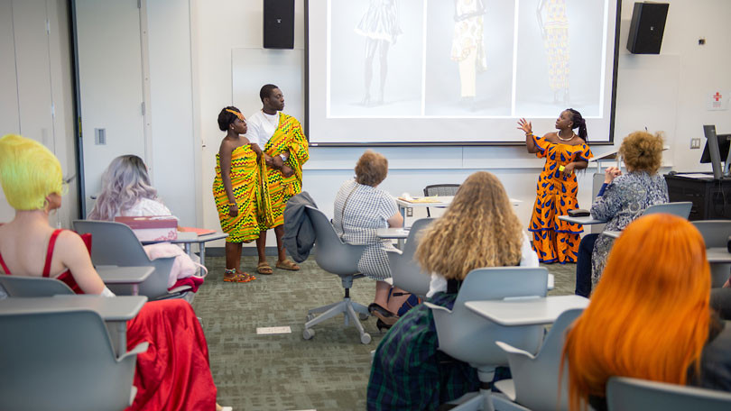 Students presenting at Scholars Day wearing traditional Ghana clothing.